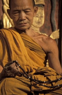 The devout at prayer. Source: http://www.religionfacts.com/buddhism/things/mala.htm